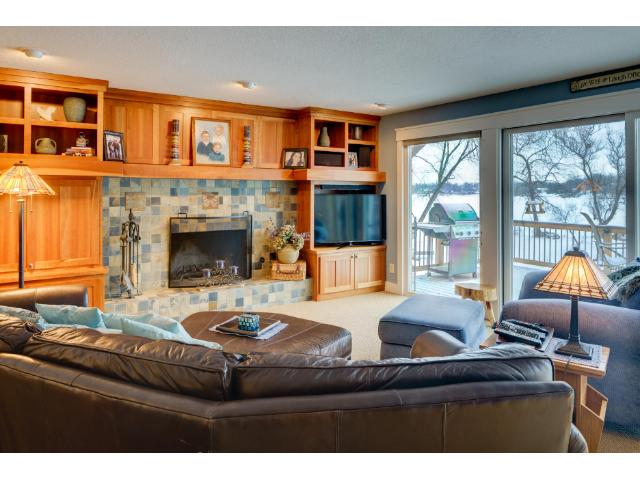 1772 Lafayette Lane, Mound, MNThe main floor family room has a gas fireplace and custom built-ins. The perfect place to relax or walk out to the new deck.