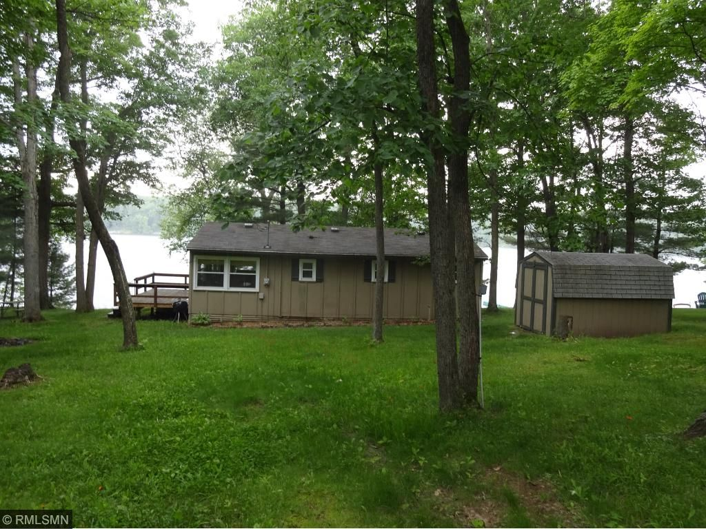 cabin, shed and bunkhouse on .4 acres with mature trees