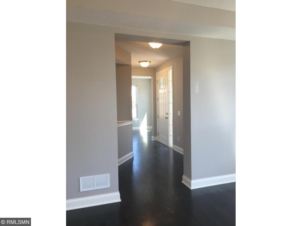 Private side entry with open foyer, hardwood floors throughout, 9ft knockdown ceilings on whole main level!!