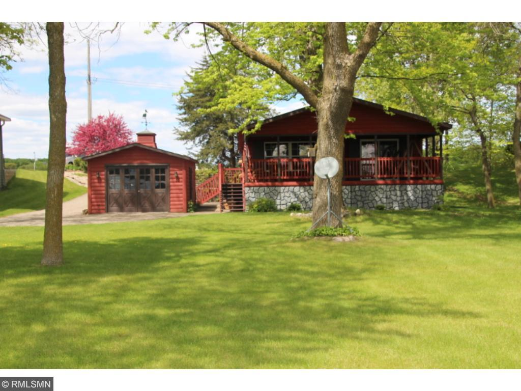 Gorgeous Lake Home & Beautiful Grounds!  This property even offers a concrete pad with electrical, to hook up an RV!