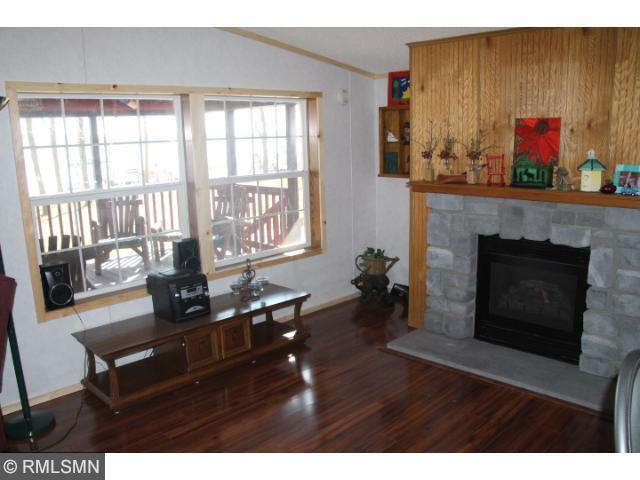 Family Room with Gas Fireplace Overlooking the Lake