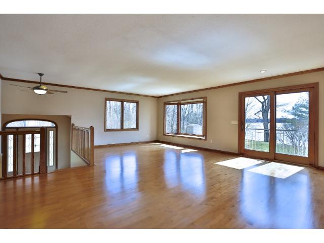 Expansive main level living room space with beautiful lake view.