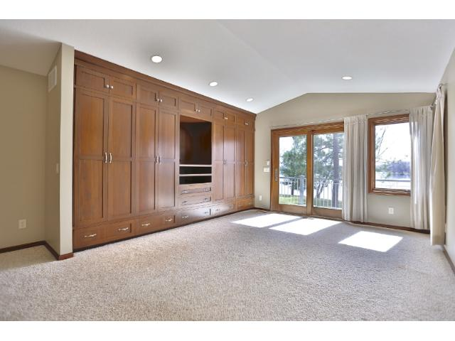 Master bedroom with custom built-ins, private bath and access out to the deck and again beautiful views of the lake.