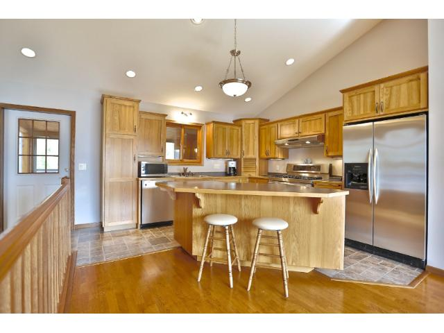Custom kitchen with hickory cabinets and stainless steel appliances.