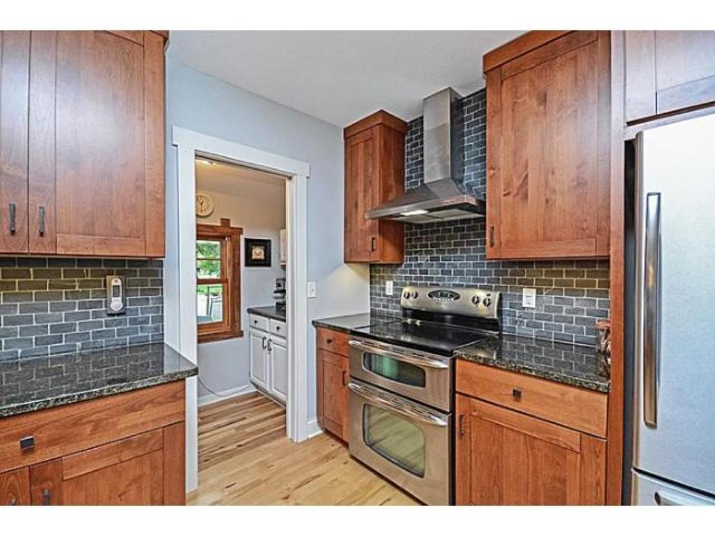 Note the pantry, attractive backsplash and some of the stainless steel appliances.