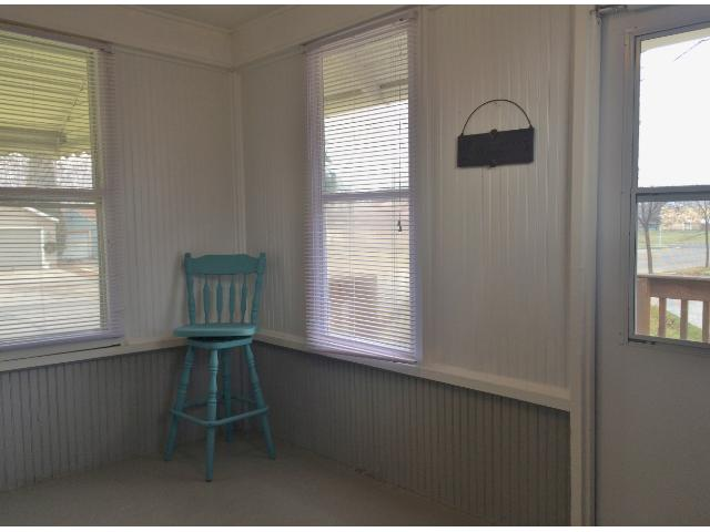 Keep the chill out of the house with both a front and this pictured back porch.  Nicely decorated and roomy.