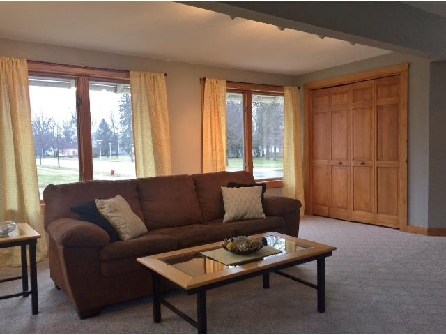The living room includes a roomy closet and lots of space for relaxing or entertaining.