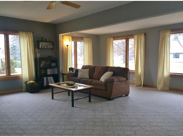 Spacious and well lit describe this comfortable living room.  The adjoining foyer is large enough to accommodate a desk for your home office.