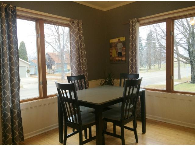 The formal dining room opens to the living room and makes for easy expansion when guests arrive.  You will love the original and well cared for hardwood floors and large windows.