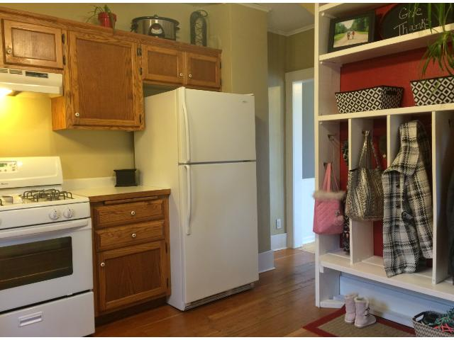 Step into the kitchen from the back porch.  Currently you will find cubbies to keep everyone organized.  This space could easily be converted to pantry space if you wish.