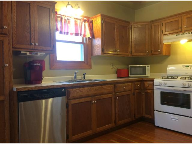 This cheery kitchen is well planned and cozy.  It offers ample cabinetry and is separate from the formal dining room.