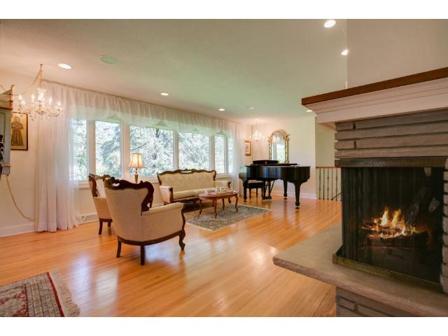 Out of the kitchen, two-sided fireplace enjoyed by most of the main floor, formal dining room and excellent entertaining space!