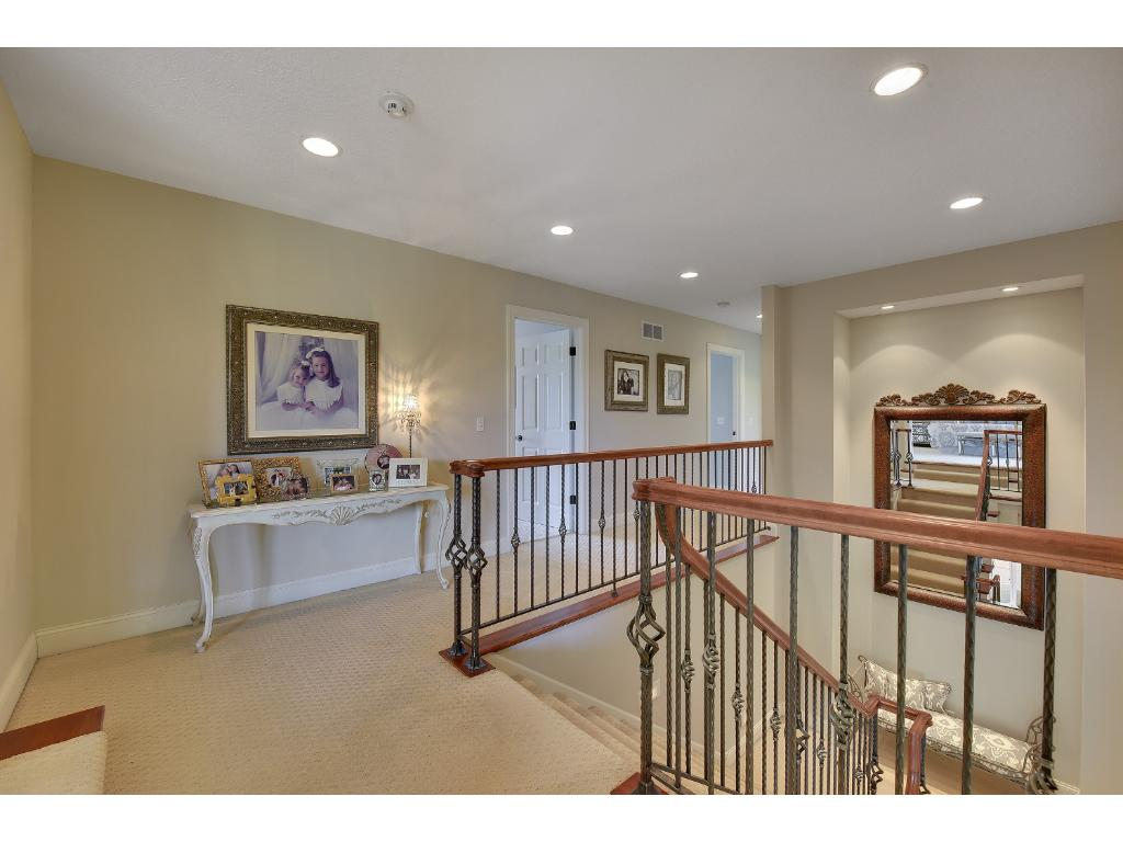 The gracious open turned staircase ascends to the large second floor landing and has a beautiful railing.