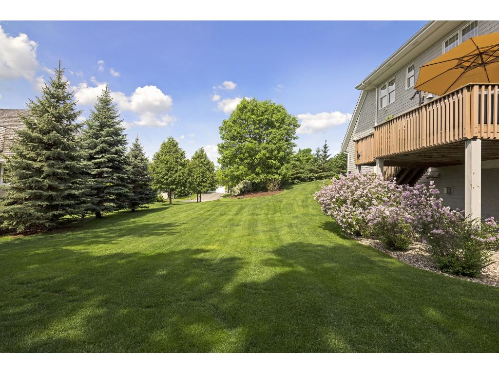 The beautiful yard offers both privacy and plenty of space for kids to play.